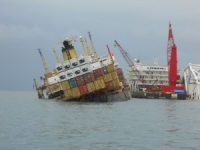 Container ship grounded and under cargo salvage