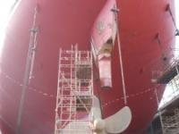 Ship's rudder removed in dry dock
